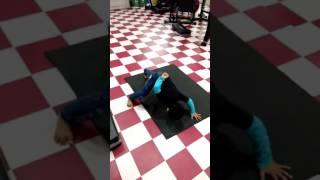 4 year  old boy doing push ups using one arm