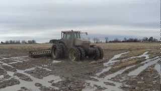 Versatile 305 Tractor rolling rice stubble near Wynne Arkansas