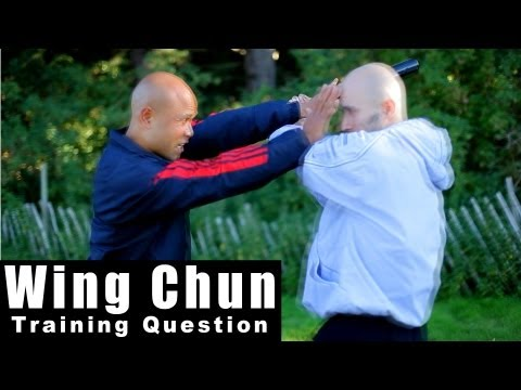 Wing Chun training - wing chun how to deal with a weapon surprise attack Q44