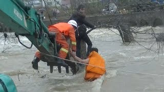 Firefighters use excavator to save woman trapped in east China river