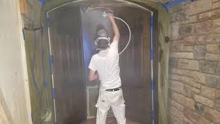 Spraying Deft waterborne polyurethane clear Satin on the Oak Door Refinish project.