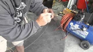 Cutting curved laminated glass