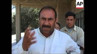 Raid on alleged Al-Zarqawi aide; wounded from gunbattle