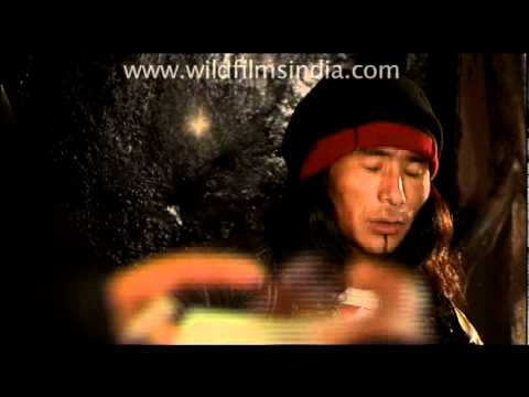 Tibetan playing guitar and singing in a cafe