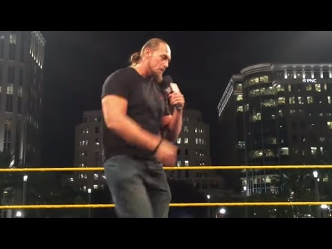 Big Cass sings Carmella's entrance theme at the WrestleMania On-Sale Party