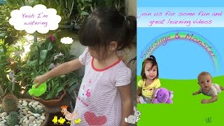 Toddler learning playing with watering can baby watering garden plants - learning baby videos