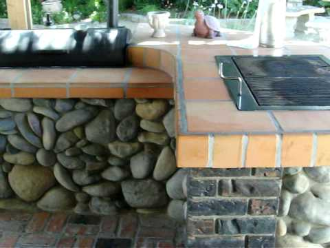 Outdoor BBQ with Masonry rock stone veneer Cultured Stone