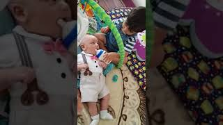 Funny baby feeding milk by another baby
