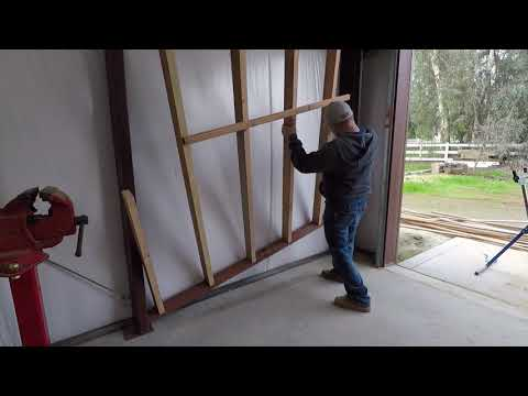 Do It Yourself Corrugated Metal And Plywood Shop Walls
