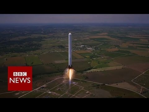 Reusable rocket blasts off and returns to earth - BBC News