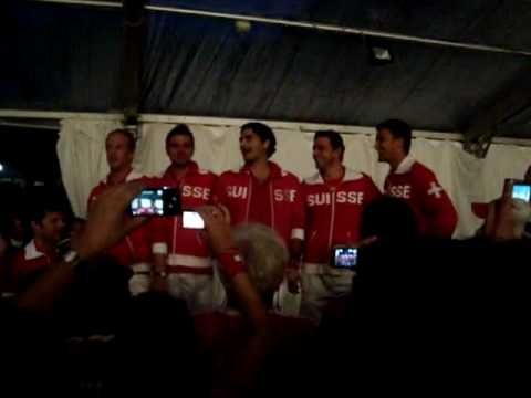 Roger Federer sings after the Davis Cup round won against Italy