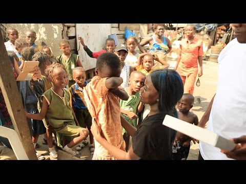 Kid in Ghetto cries after receiving shoes | Sherrie Silver