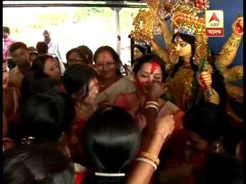 Madan Mitra beats dhak, Jun Malia dances on Ganga during Vijaya Dashami