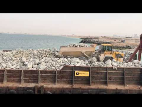 Rock barge front load ramp