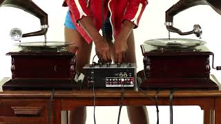 Young woman djs using two retro antique gramophones - Disco House Music