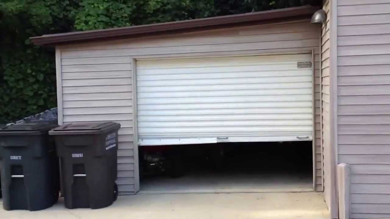 Small roll door electric opener - YouTube
