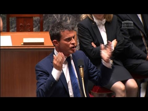 Embattled French government scrapes through confidence vote