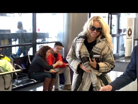 Pamela Anderson Glowing With Compliments At LAX thumbnail
