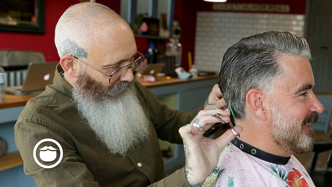 amazing salt & pepper haircut with tidy beard trim