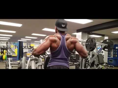 Training back. Lots of volume, with minimum rest. Chase the pump and force the muscles to grow!