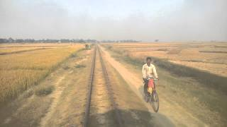 Man chasing Katwa-Balgona local on cycle