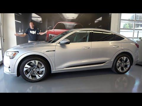 Audi E-Tron Sportback 2021 года - это люксовый спортивный электро-кроссовер.