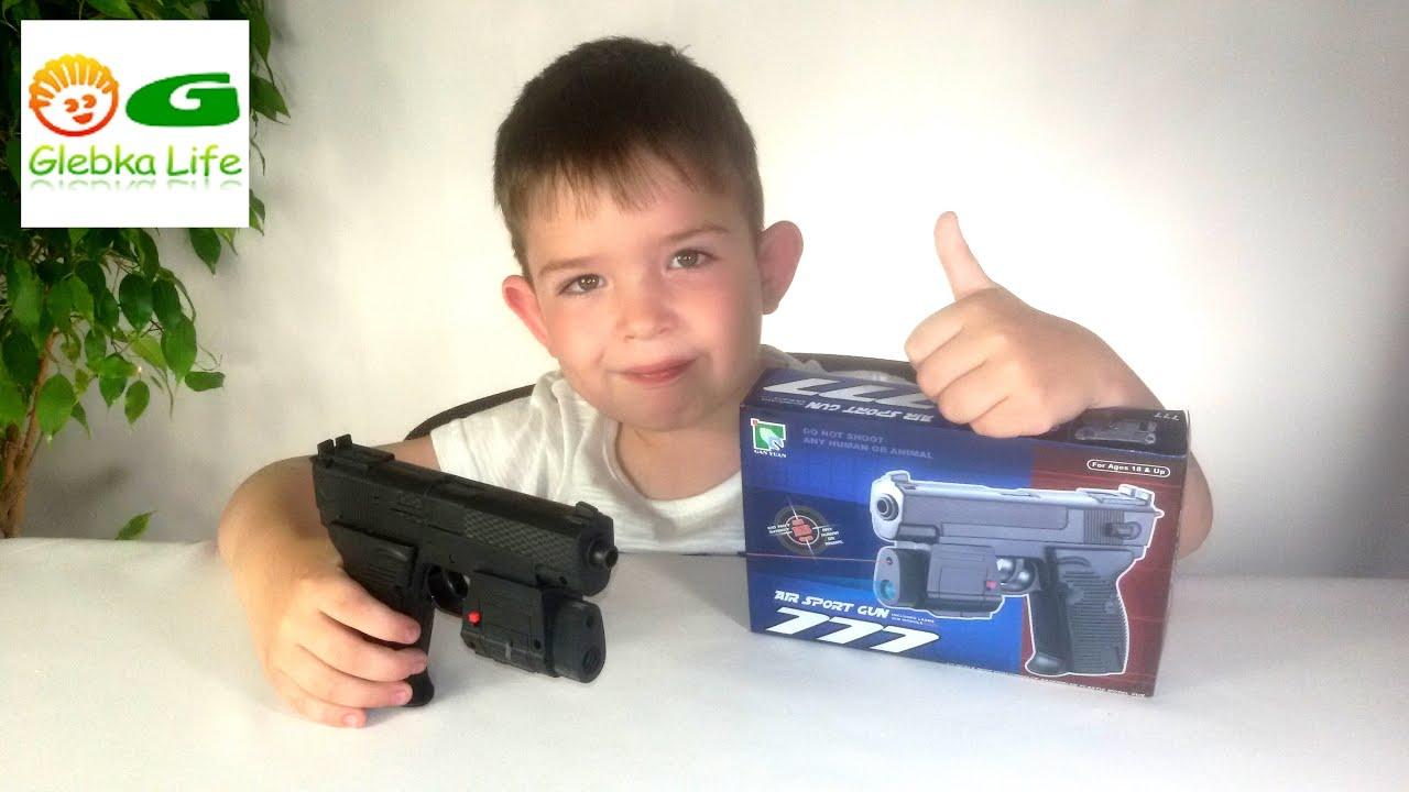 Игрушки для мальчиков, детское оружие. Пистолет лазерный на пульках. Toys for boys. Laser Gun .