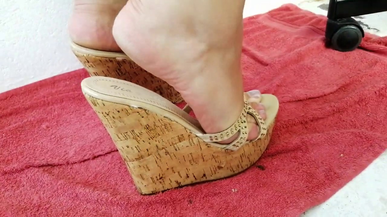 Mature feet in high heels mules Wedge