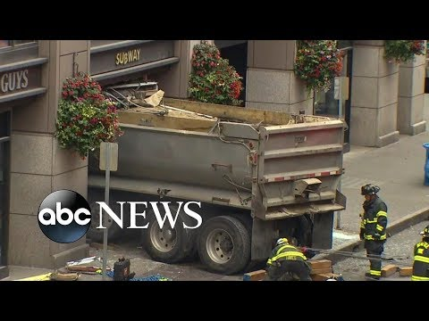 Building in Seattle evacuated after dump truck slams into eatery