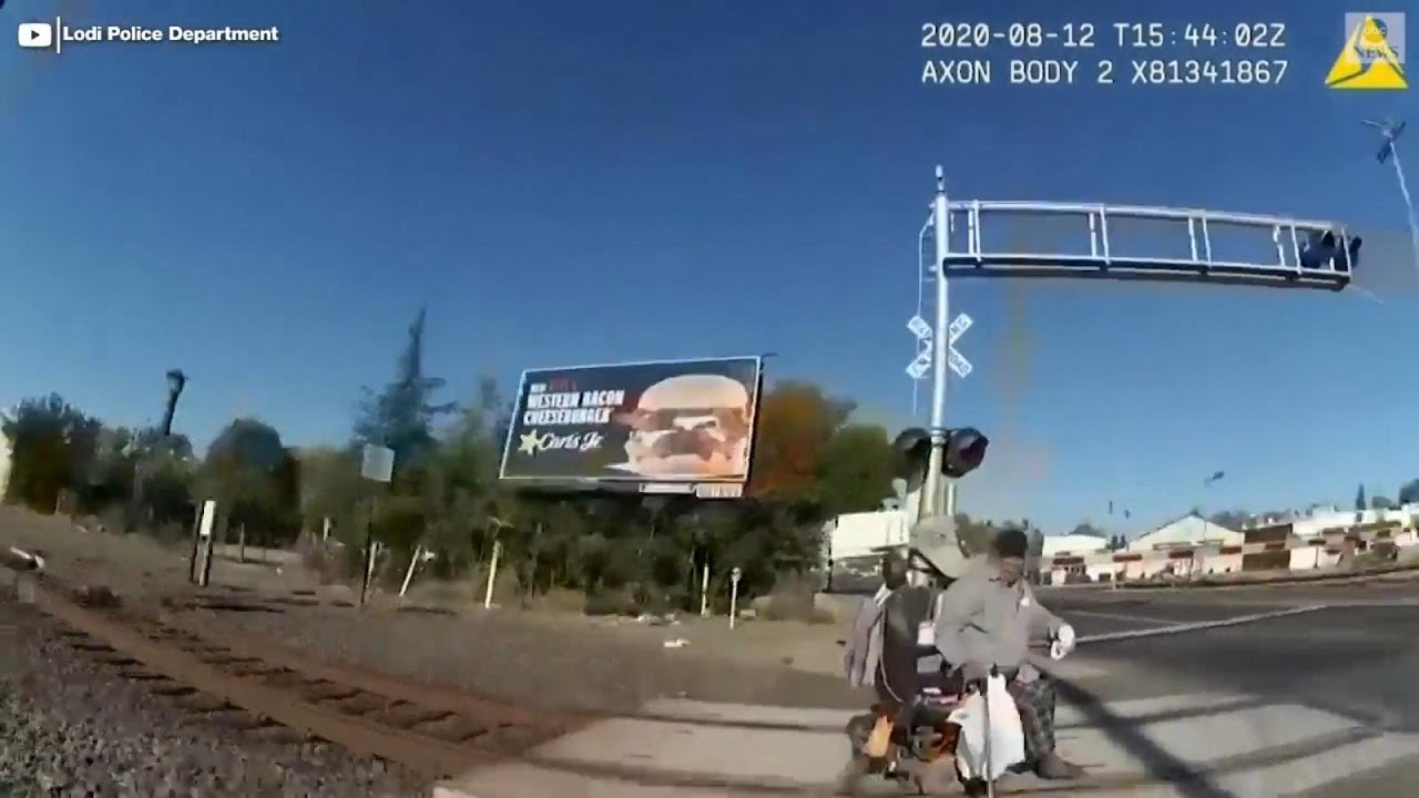 Officer saves man in wheelchair from oncoming train