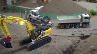 MAN TGS delivering a Liebherr 634 track loader