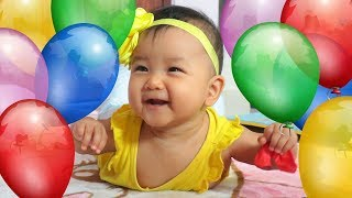 Nora Playing with Balloons