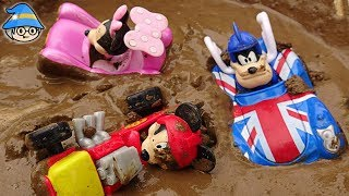 The Disney Mickey Mouse car passes through the tunnel. Car washing in the mud