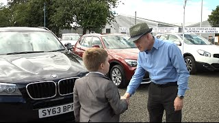 9-year-old Jason takes customer for a test drive at Alan Storrar Cars