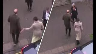 Does Prince Harry push away Meghan Markle's hand during greeting when The couple in Brixton?