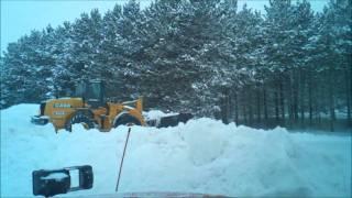 Case loader pushing back snow piles