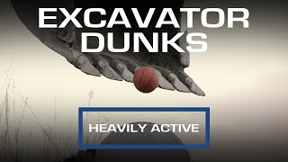 Heavy Equipment Getting Heavily Active - An Excavator Dunks