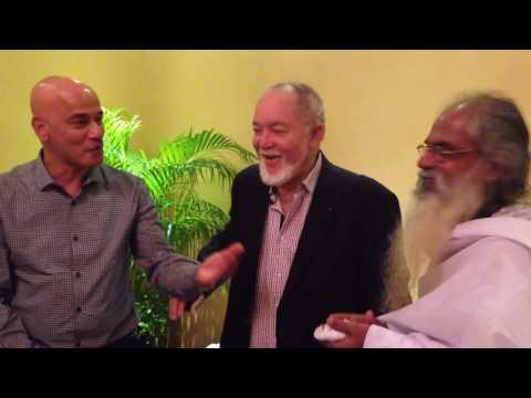Sir James Mancham singing a farewell to Swami Isa