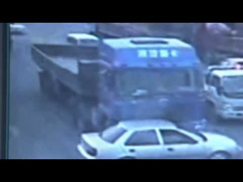 Dramatic CCTV of China car crash  Freight truck pushes car forward 500 metres