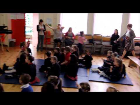 Children of St Louise School sing a long with Sinead O'Brien