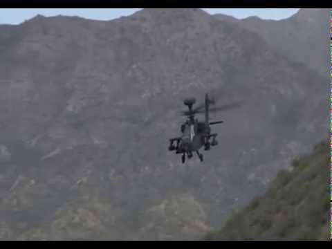 Apache attack helicopter in action