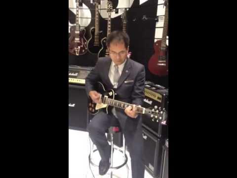 Sep 2013 in Qatar. Mj & Ac buying guitars.
