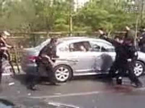 Beijing Police Subdue Knife-Wielding Assailant with Giant Sticks
