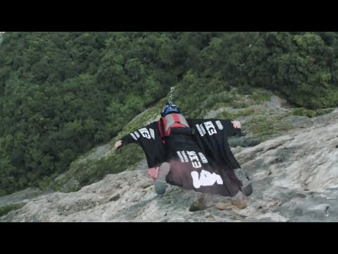 Chinese wingsuit pilot becomes the first in the world to fly through a moving target