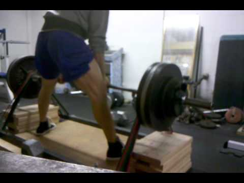 Deadlift lockouts 415 plus 250 lbs of bands