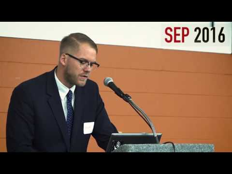Niles Niemuth addresses Socialism vs Capitalism and War conference