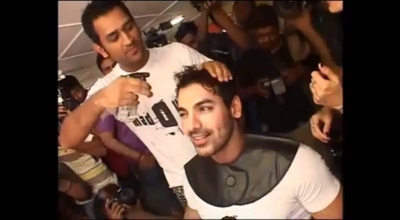M S Dhoni giving a Hair Cut to John Abraham