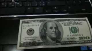 اكتشاف العين الماسونية في 100 دولار