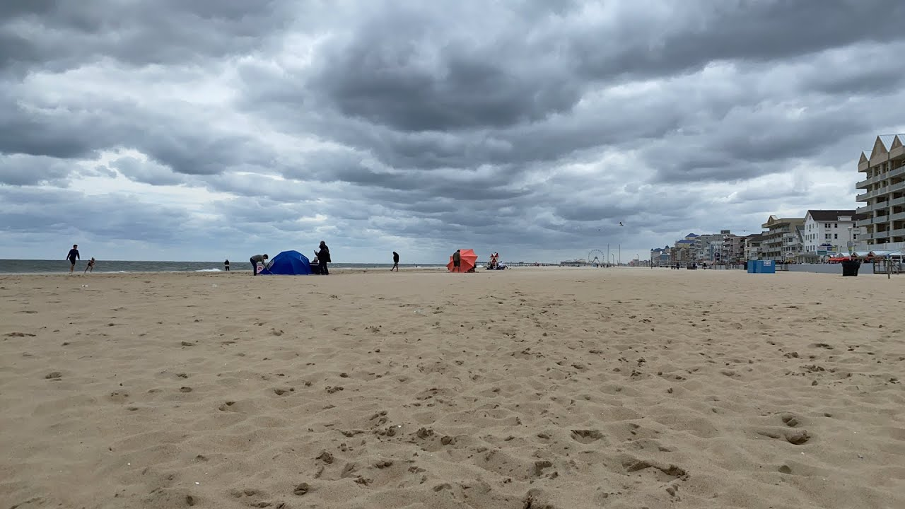 Beachgoers social distance at Ocean City Maryland