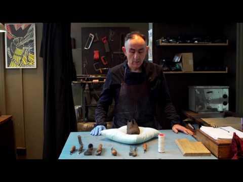 Shoemaker Andrew McDonald Examines A Convict Shoe